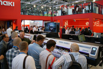 Visitors crowd around the Mimaki JV300 – launched at FESPA Digital 2014