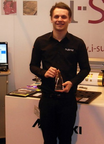 Hybrid's Sam Mitchell with the Trophex award for Most Pioneering Product – won by the Mimaki UJF-6042