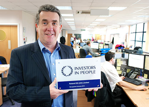 Jerry Davies, Managing Director, Roland DG (UK) with IIP Award